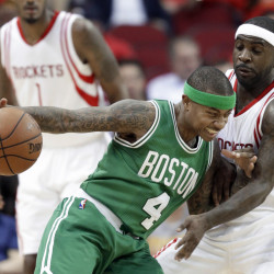 Celtics guard Isaiah Thomas pushes against the Rockets' Ty Lawson on a possession in the first half of Boston's win Monday night in Houston. Thomas led the Celtics with 23 points in the game.