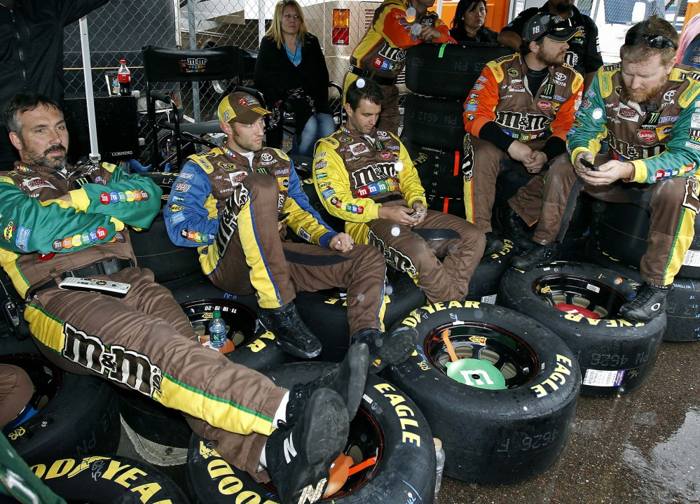 Pit crew members for Kyle Busch had to sit on their racing tires while waiting out a rain delay at the NASCAR Sprint Cup race Sunday at Phoenix International Raceway.