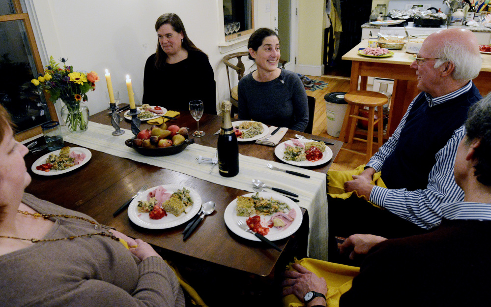 Portland Press Herald food editor Peggy Grodinsky, center, entertains her guests with a variety of food for the Portland Press Herald Signature Dish(es) Thanksgiving dinner.