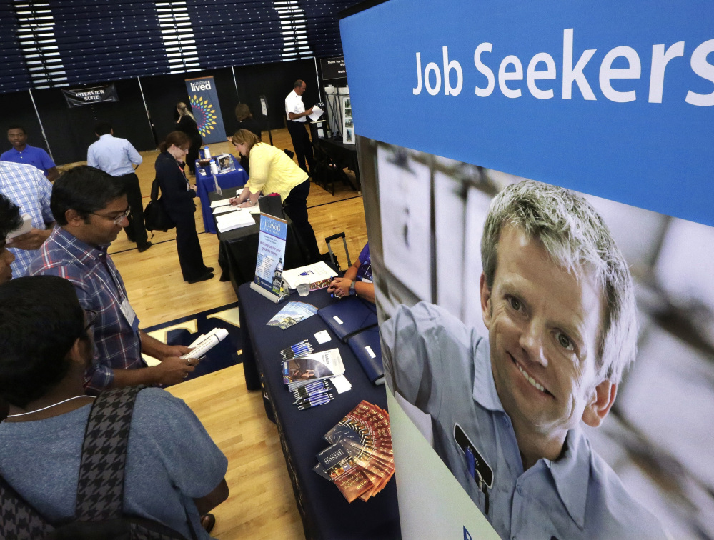 Students seeking entry into the workplace, such as these at The Foot in the Door Career Fair at the University of Illinois last year, might find more opportunities in 2016 as the national economy seems to be picking up steam.