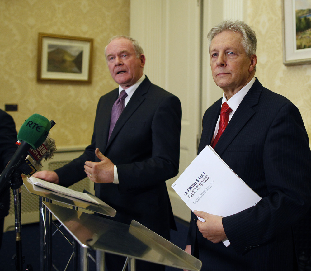 Northern Ireland First Minister Peter Robinson, right, and Deputy First Minister Martin McGuinness spent more than a year working on a deal between Catholics and Protestants.
