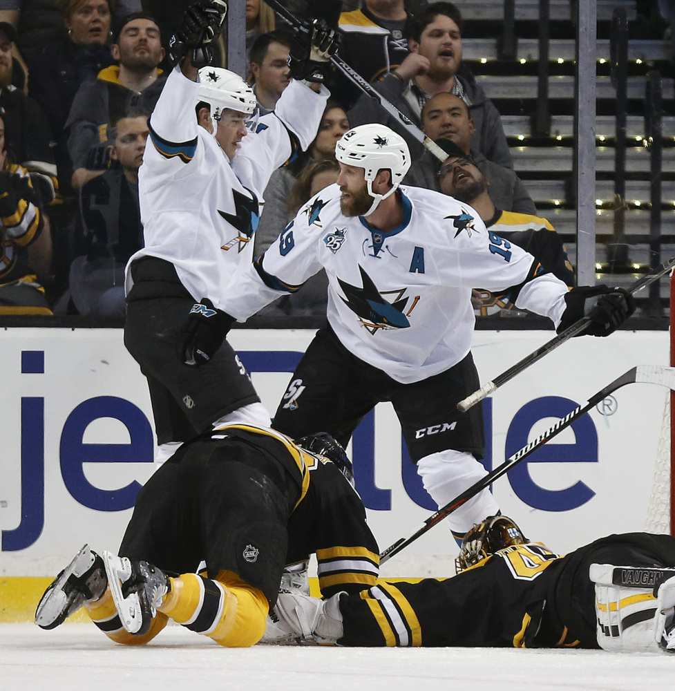 San Jose's Patrick Marleau, back left, celebrates his goal with teammate Joe Thornton (19) in the second period.