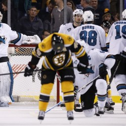 The Sharks' Martin Jones, left, stands in the net as the Bruins' David Krejci, foreground center, skates away while the Sharks celebrate their 5-4 win over Boston on Tuesday night.