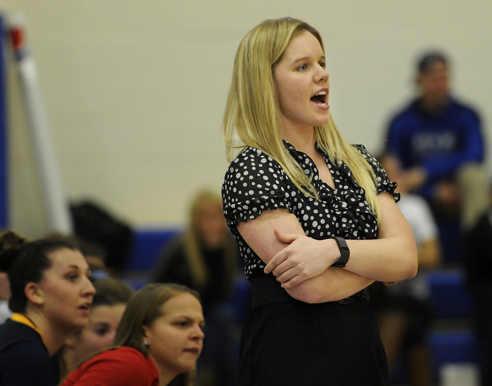 Samantha Allen, who took over as USM coach when Gary Fifled left after 27 years, encourages her players Tuesday night against UNE at Biddeford. Allen's Huskies fell short down the stretch in losing 74.62.
