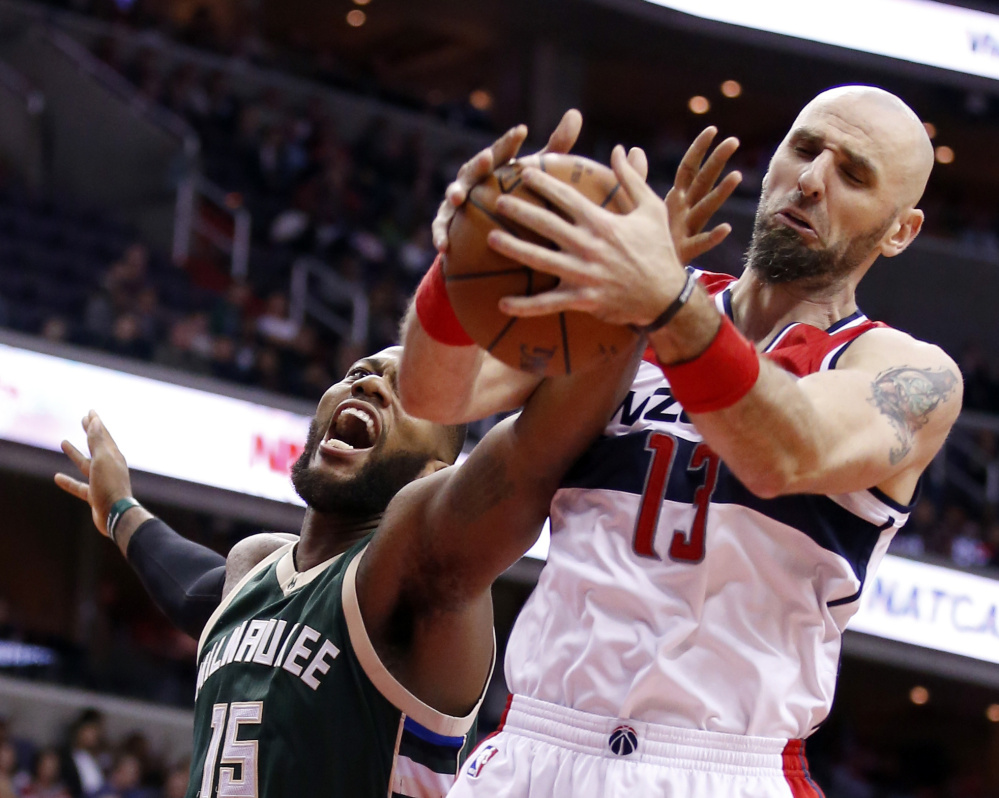 Bucks center Greg Monroe, left, attempts to keep a rebound from the arms of Wizards center Marcin Gortat during Tuesday's game, a 115-86 Washington home win.