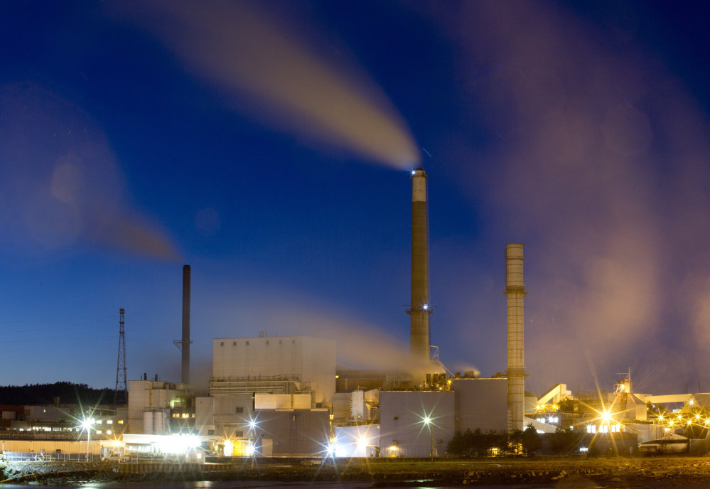 A three-minute exposure shows smoke emitted by the Verso paper mill in Bucksport before it closed last year. Maine exported pulp and paper worth nearly $500 million in 2014, easily topping lobster exports at $349 million.