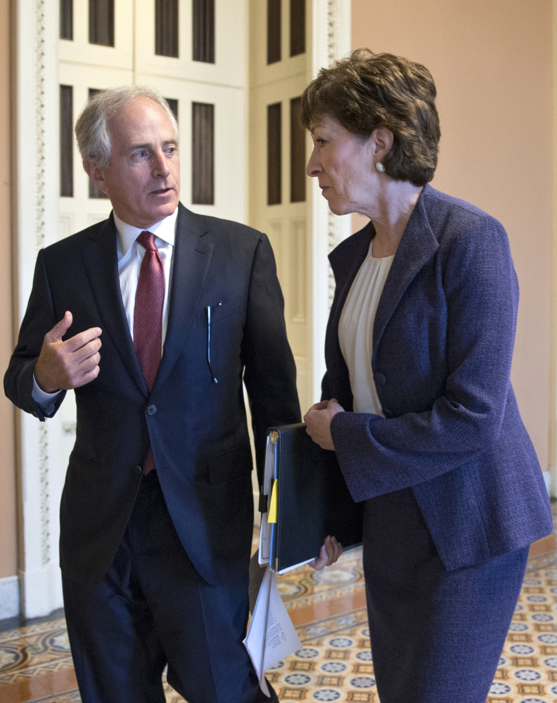 Sen. Susan Collins, R-Maine, confers with Senate Foreign Relations Committee Chairman Sen. Bob Corker, R-Tenn., Wednesday on Capitol Hill.
