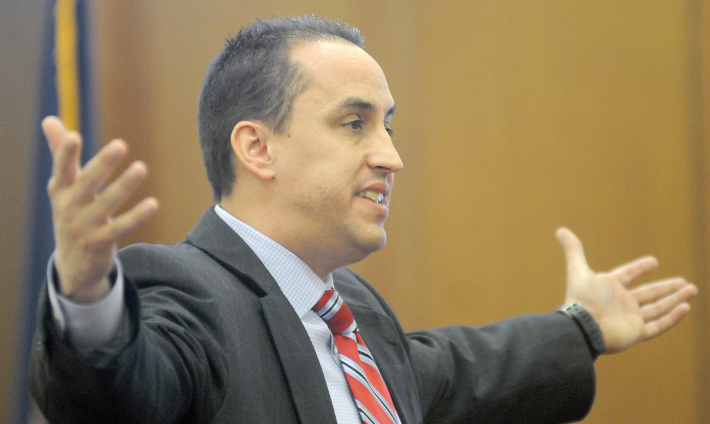 Defense attorney Darrick Banda makes closing arguments Wednesday during the trial of Roland J. Cummings in Augusta.
