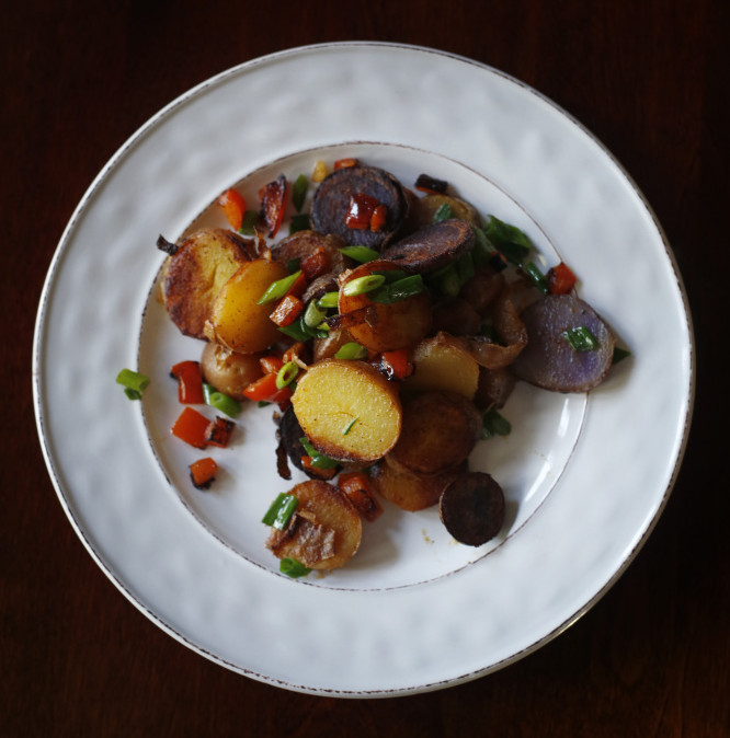 Local fingerling potatoes three ways: Sliced and pan-fried with green onions ...