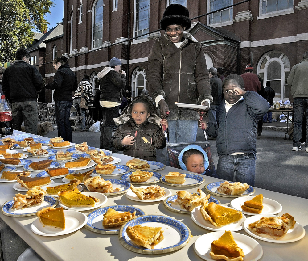 Betty Lasu and her family check out the pie selection at a Parkside block party in 2009. There is much to celebrate about the Portland neighborhood, a homeowner says.