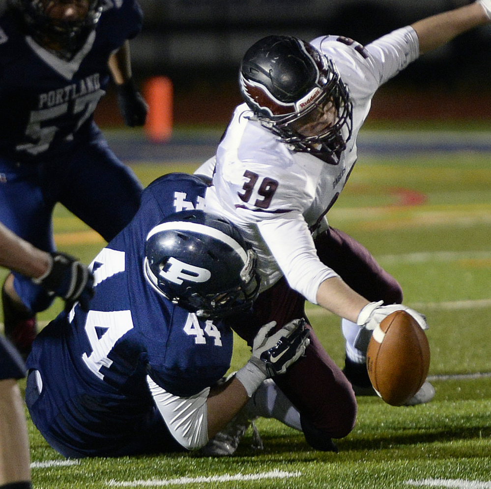 Joe Fusco of Portland, 44, forces a fumble, and that's nothing new. Just part of a can-do-it-all defense that has five shutouts in 10 games.
