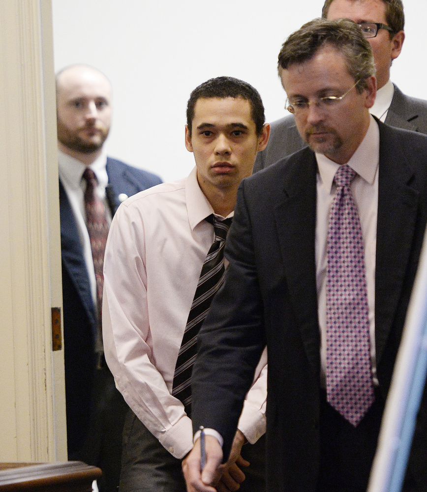John Lopez, center, is among the men accused of murdering a Biddeford man in 2013. At right is his appointed attorney, Robert Ruffner.
