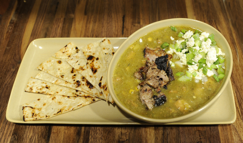 Green chili with smoked pork and scallions.