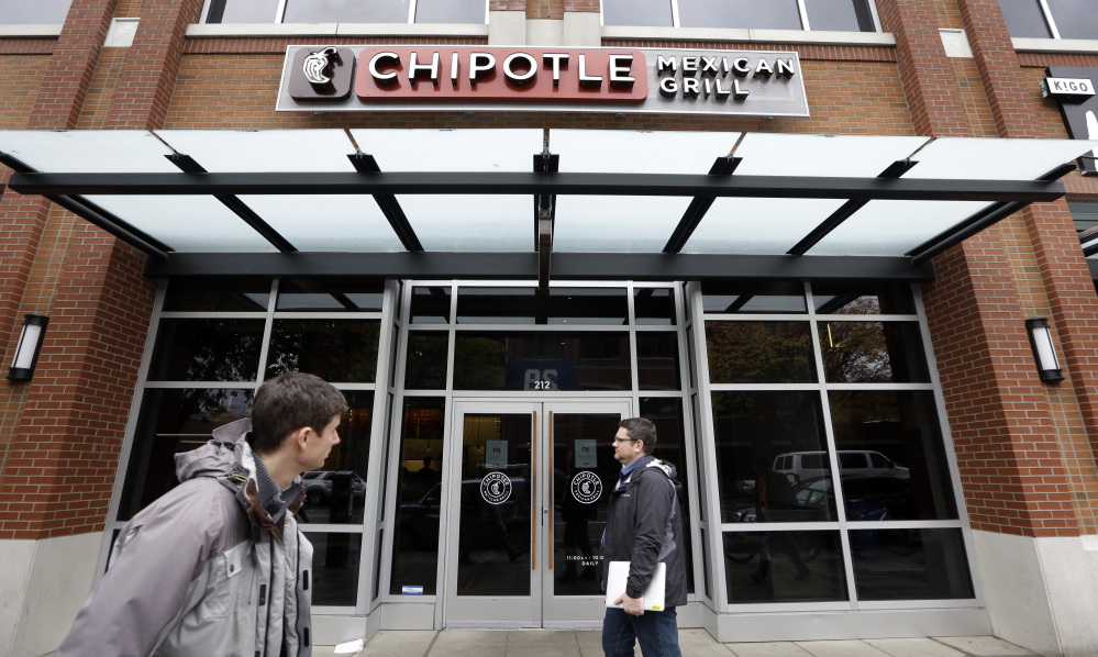 A Chipotle spokesman says the company will not close any restaurants, though an outbreak of E. coli now includes cases in New York, California and Ohio.