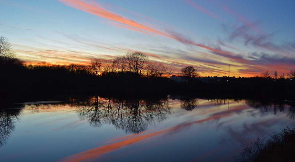 The reflection of a long thin cloud at sunset over Clark Pond in South Portland gives an arrow-like image that Brian K. Lovering of North Yarmouth captured before dusk.