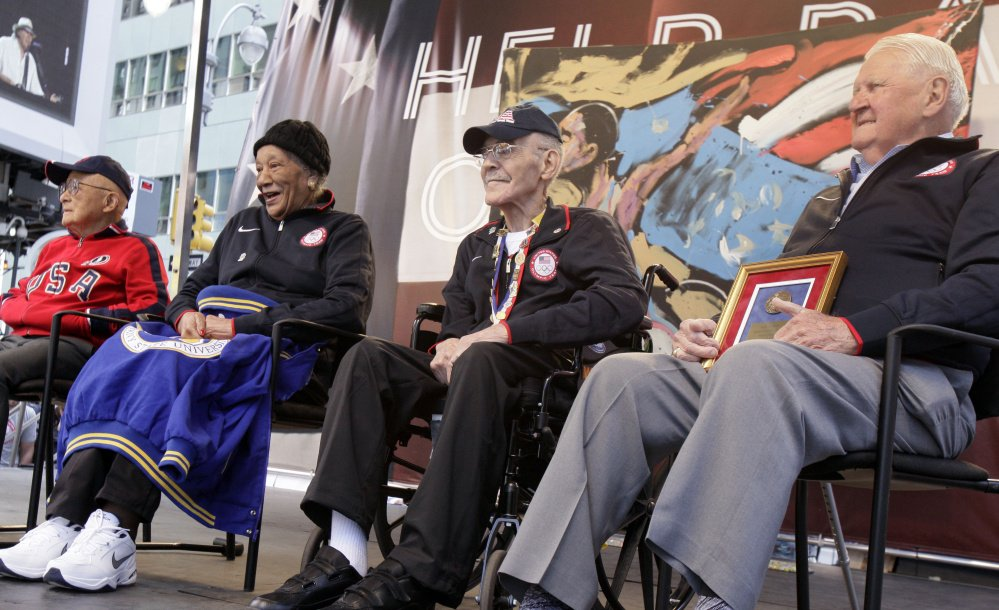 Mal Whitfield, third from left, and other members of the 1948 U.S. Olympic team participate in U.S. Olympic team festivities. Whitfield was a Tuskegee Airman during World War II and a foreign service officer and sports ambassador.