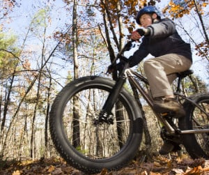 "11-year-old Eoin O'Mahoney likens the fat bike's ride to that of a car as he leads a youth ride  at Hidden Valley Nature Center in Jefferson. ""It's very stable,"" he says. ""You can ride over anything and hardly feel it."""