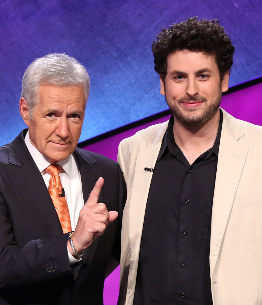 """Jeopardy!"" host Alex Trebek, left, appears with Alex Jacob, winner of the ""Tournament of Champions."""