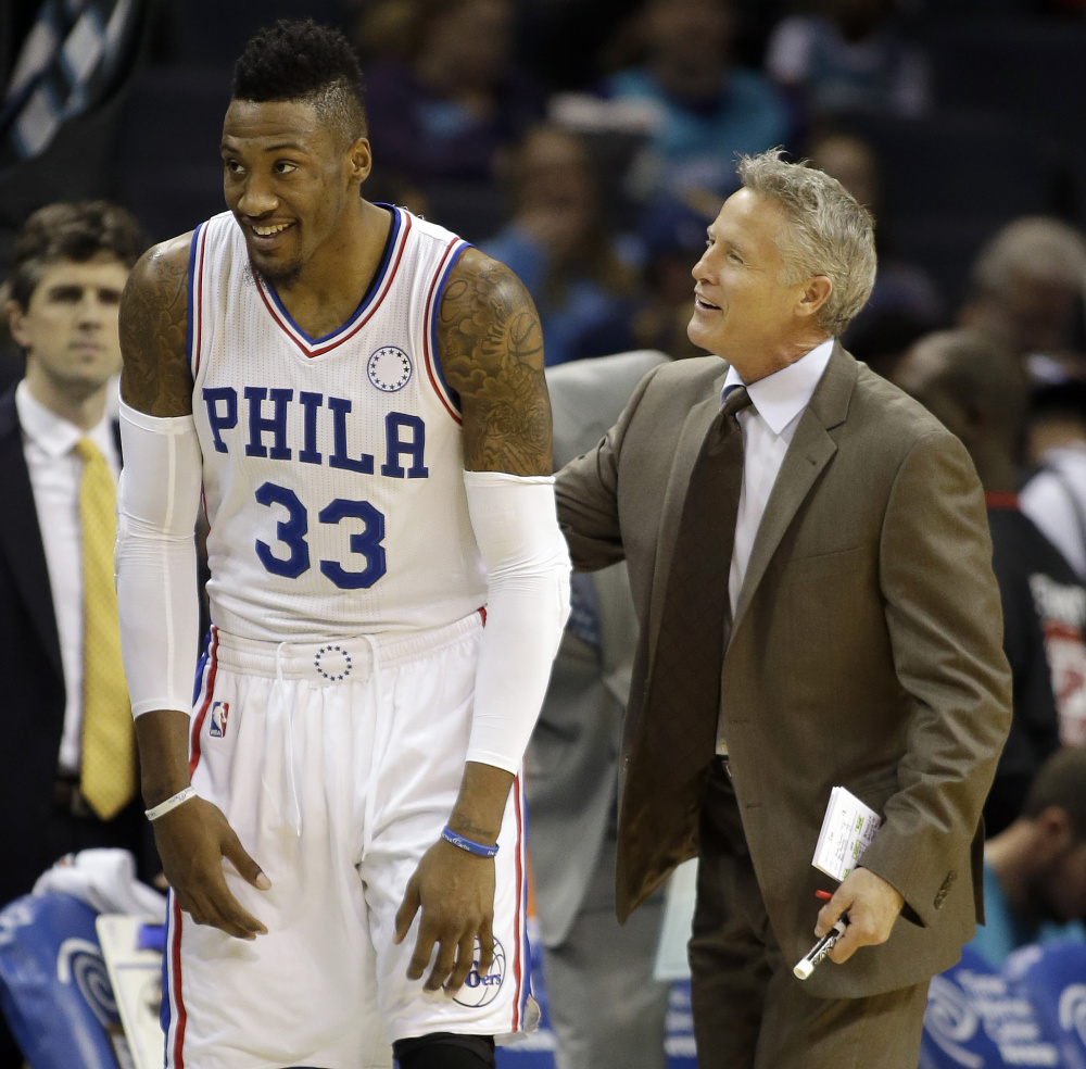 Philadelphia Coach Brett Brown, a South Portland native, talks to Robert Covington during the 76ers' 113-88 loss Friday night at Charlotte. The Sixers are 0-13.