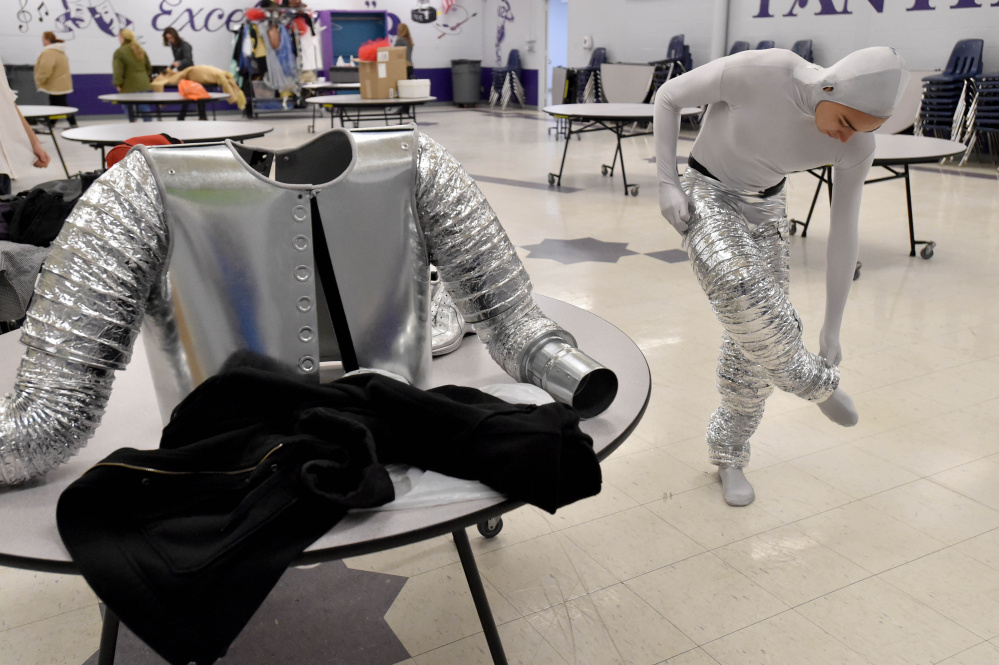 Alan Baez puts on the Tin Man costume that was built and donated by Jim Grenier of Charles B. Davis Co. in Waterville.