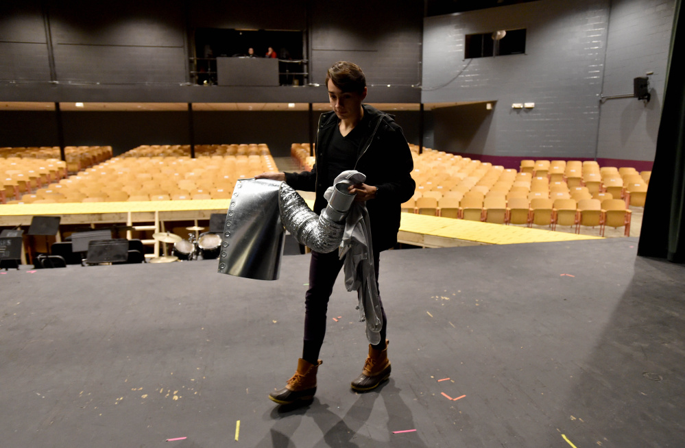 Alan Baez carries a portion of his Tin Man costume across the stage at Trask Auditorium.