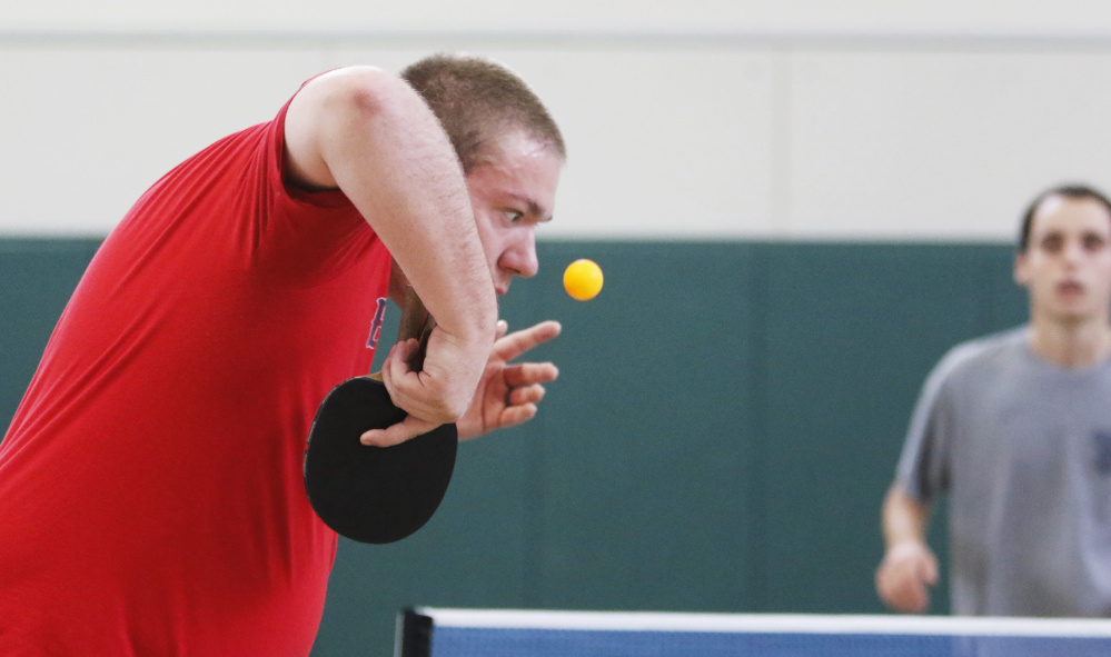 T.J. Braley of Lee sets up his serve to Sebastian Taylor during a match at the Maine State Championship Tournament for table tennis at Pineland Farms. Jill Brady/Staff Photographer