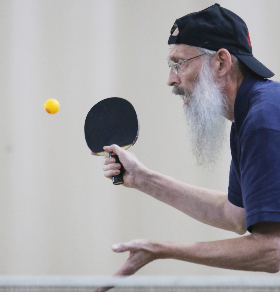 Taylor Pancoast concentrates. The tournament is named for Arthur Lekousi, a former champ and retired Portland High School teacher.