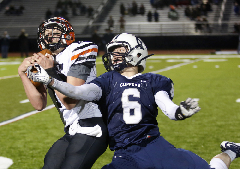 Jacob Trask of Winslow intercepts a pass intended for Jack Snyder in the fourth quarter, helping the Black Raiders secure their victory.