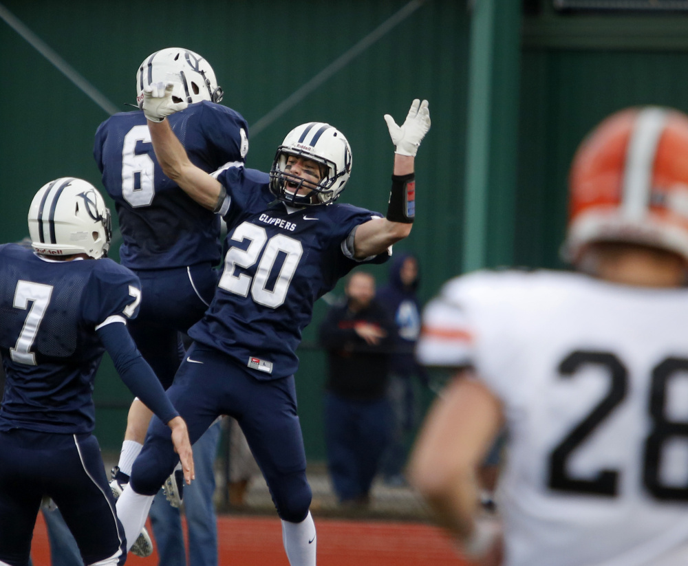 Remi LeBlanc, center, of Yarmouth celebrates with teammates after a 49-yard touchdown reception in the second quarter.  It was the only touchdown for Yarmouth, which had its bid for an undefeated season spoiled by Winslow.