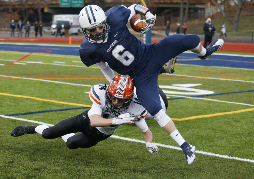 Jack Snyder of Yarmouth tries to avoid Dylan Hutchinson during the second half of Saturday's Class C state championship game at Fitzpatrick Stadium in Portland. (Derek Davis/Staff Photographer)