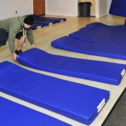 Homelessness may have declined by some measures, but people still rely on mats in the Portland overflow shelters on a nightly basis.