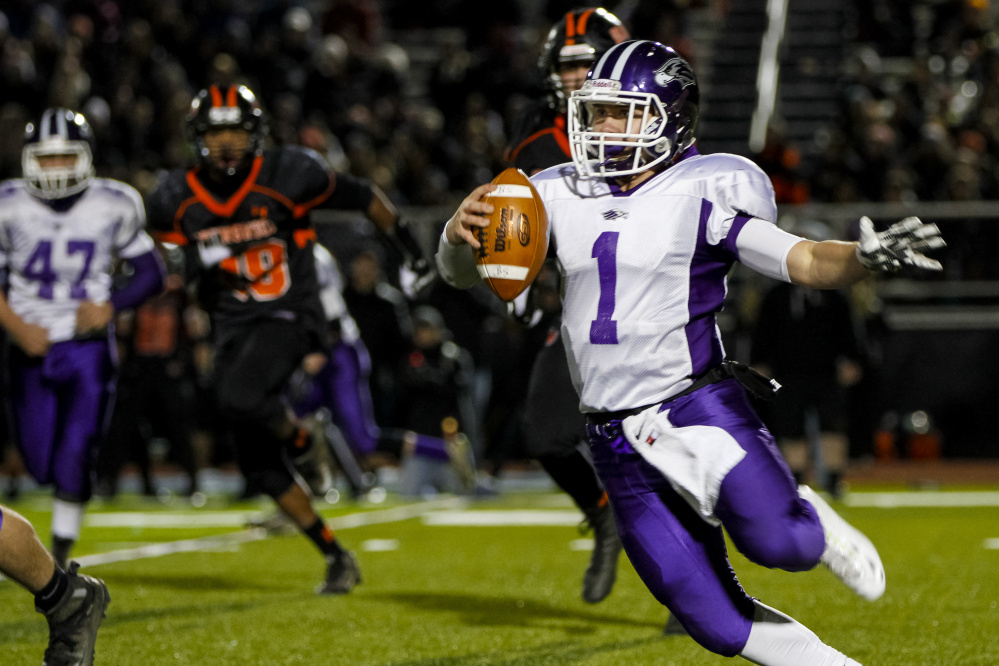 Marshwood quarterback Cole McDaniel looks for an opening during the fourth quarter against Brunswick.