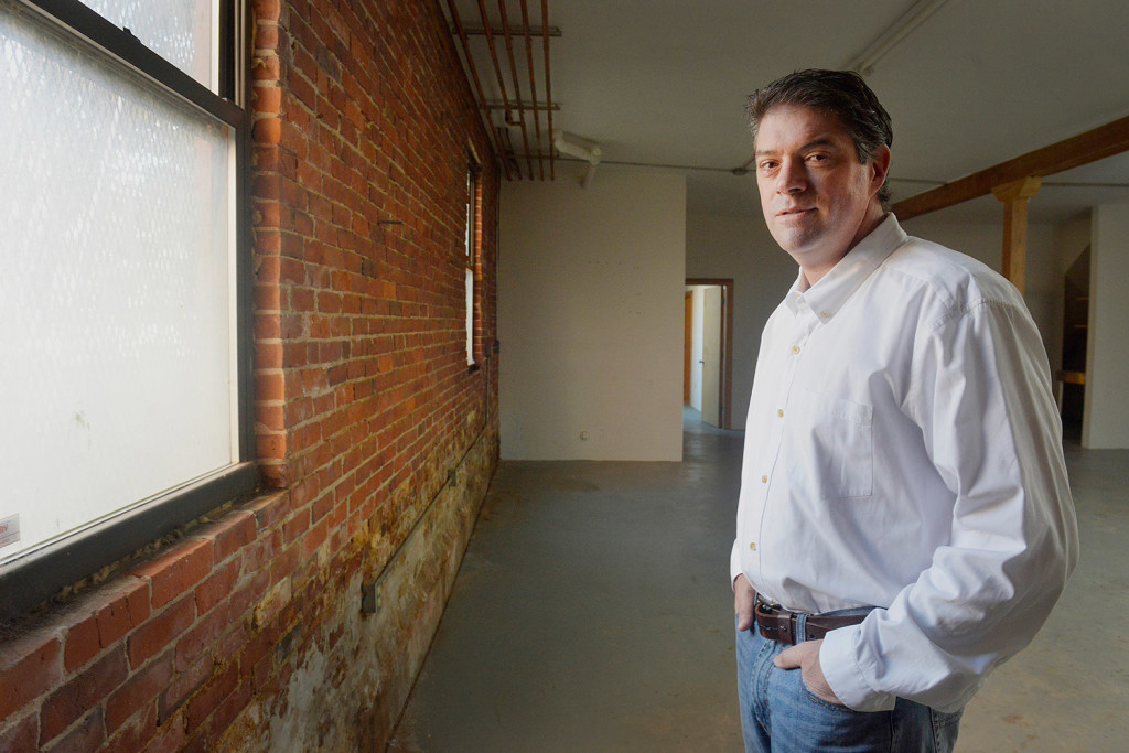 Kevin Dwyer stands in the empty building at 273 Congress St., which he and his partners planning to convert to retail space and condo units. John Ewing/Staff Photographer