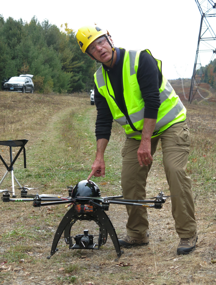 Bernd Lutz, CEO of Boulder, Colorado-based bizUAS Corp., which provides drone services for utilities and other industries, prepares to demonstrate the use of a Cyberhawk octocopter drone for power line inspections at a New York Power Authority site in the Catskills, near Blenheim, N.Y.