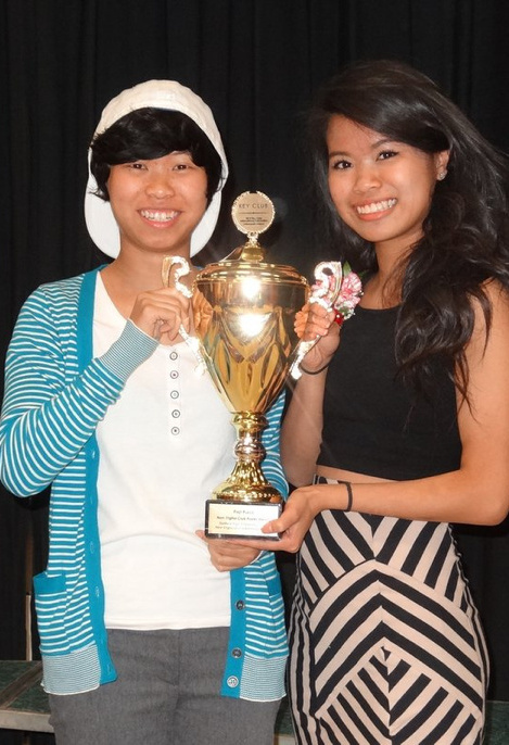 Sanford High School Key Club members Michelle Ouch, left, and Cherlline Ouch pose with a trophy they won for their prize-winning recruiting poster.