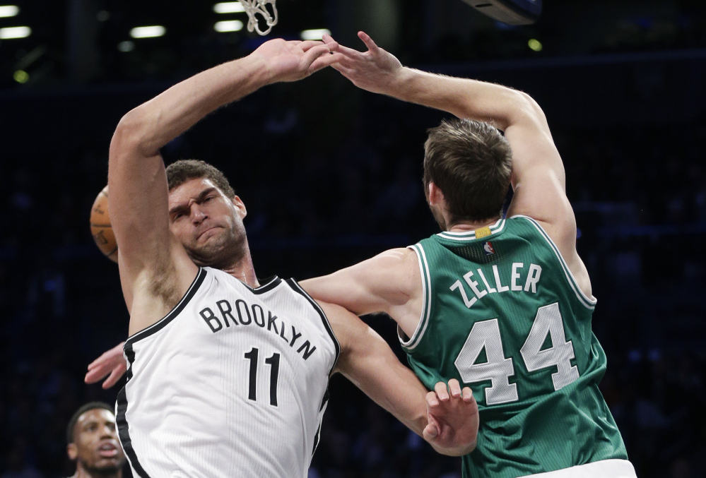 Brooklyn center Brook Lopez, left, blocks a shot by Boston center Tyler Zeller during the Nets' 111-101 win Sunday in New York.