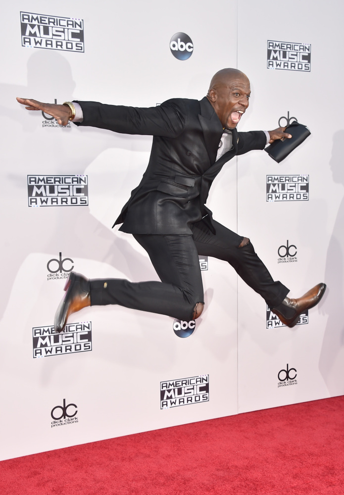 Terry Crews arrives at the American Music Awards in Los Angeles on Sunday.