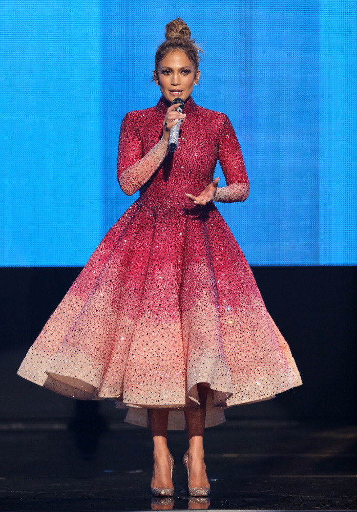 Jennifer Lopez speaks at the American Music Awards on Sunday in Los Angeles.