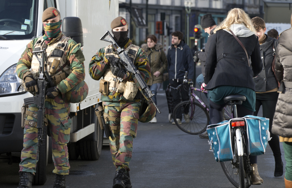 Belgian Army soldiers patrol the center of Brussels on Monday.