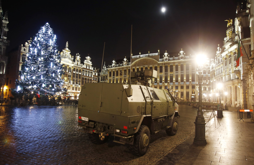 A police vehicle is parked at the Grand Place in downtown Brussels, Belgium, on Monday.