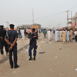 Security officers stand guard at the scene of an  explosion at a mobile phone market Wednesday in Kano, Nigeria.