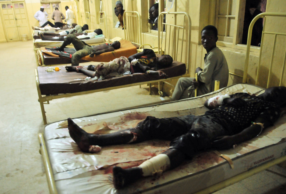 Injured males receive treatment at a local hospital following an explosion at a mobile phone market in Kano, Nigeria. Wednesday Nov. 18.