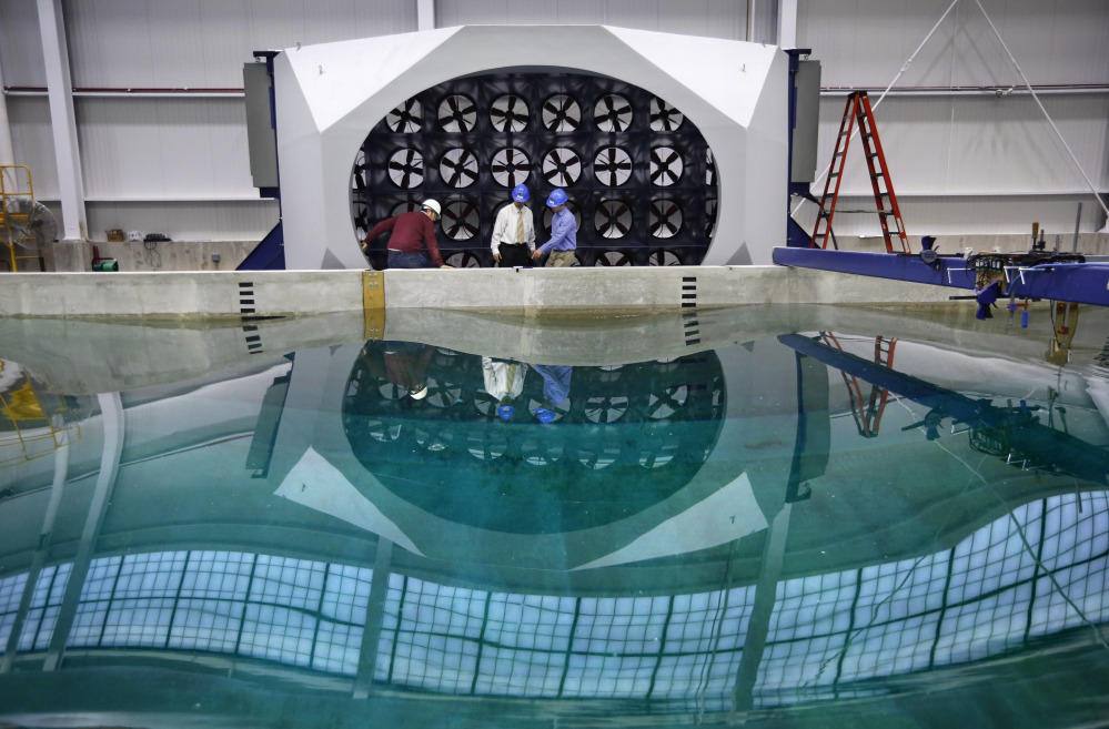 Waves distort the reflection in an indoor wave pool and wind tunnel at the University of Maine in Orono. The university's new wind-wave basin is capable of simulating some of the worst conditions at sea at a 1:50 scale.