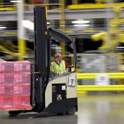 A forklift operator moves goods at an Amazon.com fulfillment center in DuPont, Wash. Amazon can afford to offer delivery services that other retailers can't.