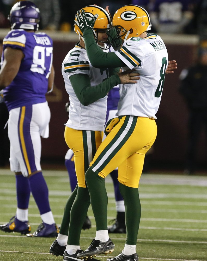 Green Bay kicker Mason Crosby, left, was fairly busy in a 30-13 win over the Vikings on Sunday, but the defense was superb in holding Minnesota to 94 yards rushing.