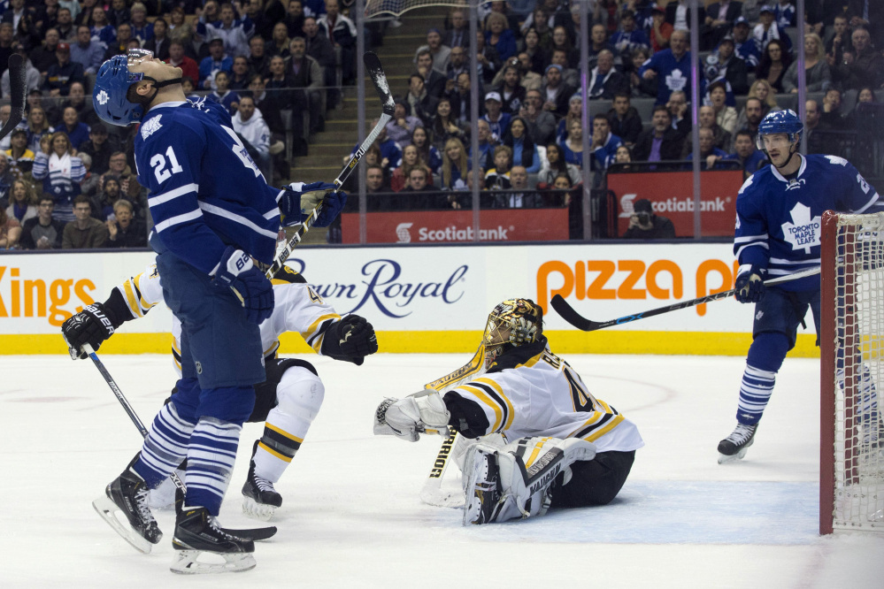 The Maple Leafs' James van Riemsdyk, left, reacts after getting stopped by Bruins goaltender Tuuka Rask at the end of overtime. The game went to a shootout and the Bruins won.