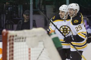 The Bruins' Zac Rinaldo, left, is congratulated by Landon Ferraro after scoring in the first period of Monday night's game in Toronto. The Bruins ended up winning in a shootout, 4-3.