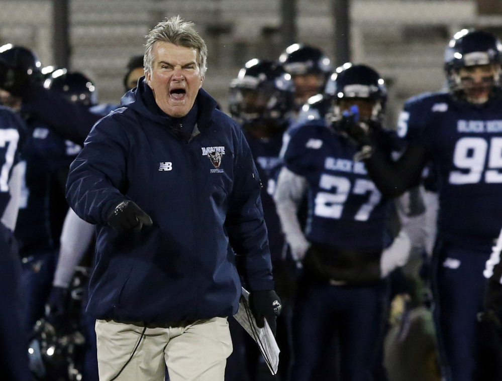 Coach Cosgrove disputes a call with referees in a football game last year. He coached his last game Saturday, a 22-6 loss to New Hampshire that left the Black Bears with a 3-8 record, UMaine's worst since 1995.