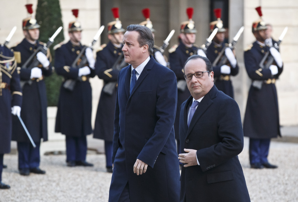 Britain's Prime Minister David Cameron, left, and France's President Francois Hollande arrive at the Elysee Palace in Paris, on Monday.