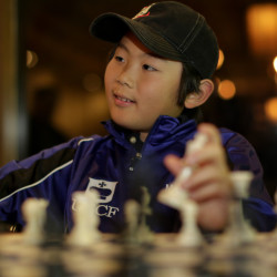 Maximillian Lu wasn't quite 10 years old when he became the youngest chess master, and he recently represented the U.S. in international competition in Greece.